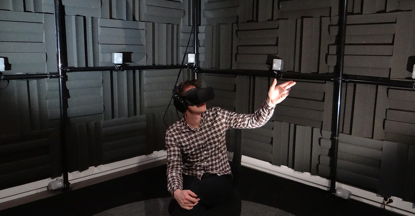 Person inside of sound room with vr headset on