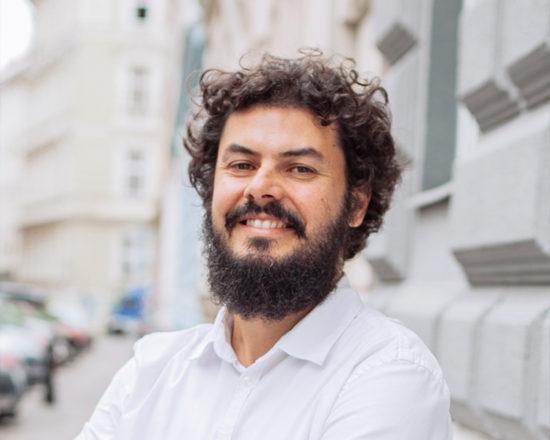 man with beard smiling at camera